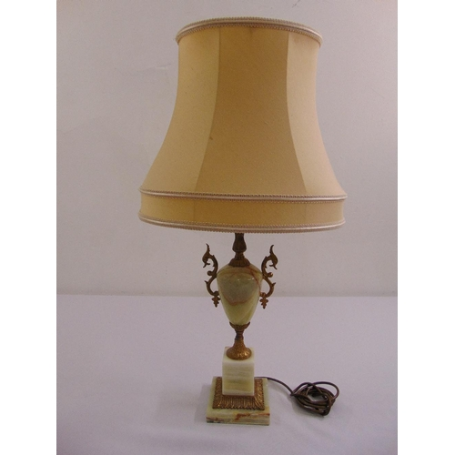 23 - An onyx and gilded metal table vase form lamp to include silk shade...