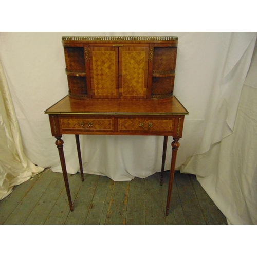 3 - A French style rectangular bureau with brass mounts and galleried back section with two hinged doors...