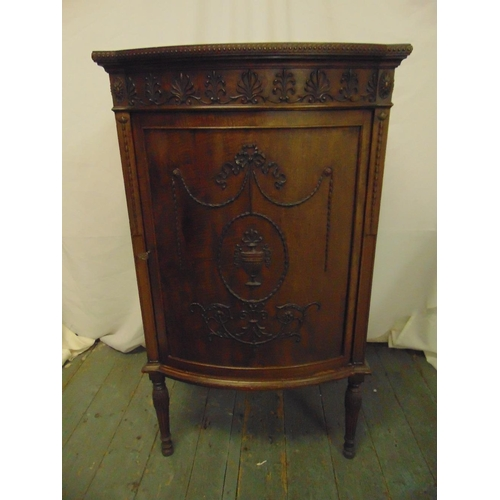 4 - A shaped rectangular mahogany music cabinet, bow front with anthemion border, the hinged door with c...