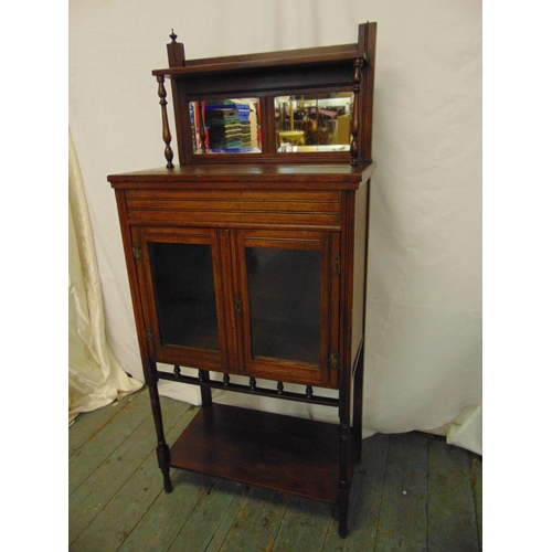 6 - An Edwardian rectangular mahogany hall cabinet with mirrored back and glazed hinged doors A/F...