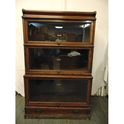 1 - Globe Wernicke three section glazed bookcase with single base drawer section and top plinth...