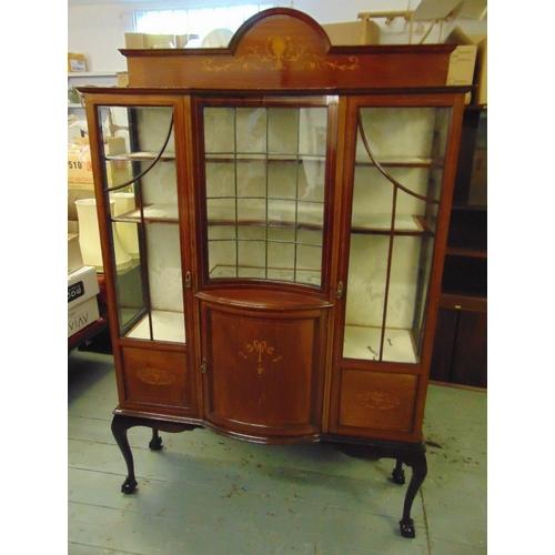 11 - An Edwardian shaped rectangular inlaid mahogany glazed display cabinet on four cabriole legs...