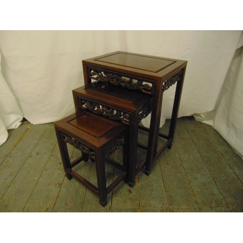 14 - A Chinese nest of three rectangular hardwood tables...