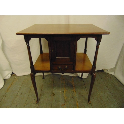 17 - A mahogany rectangular occasional table with cupboard and single drawer on four tapering cylindrical...