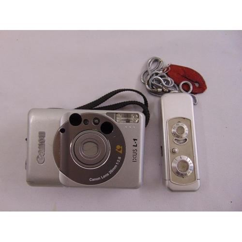 198 - A Minox spy camera and a Cannon IXUS L1 camera...