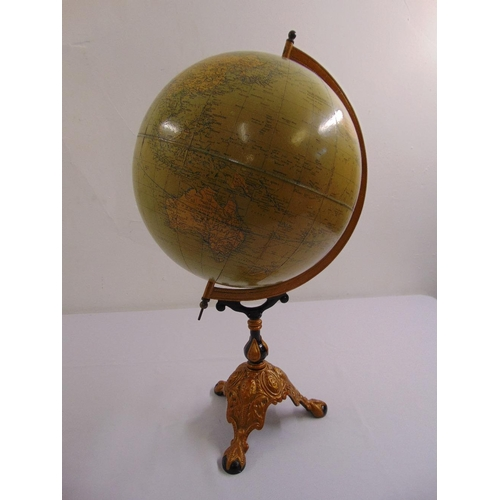 199 - An antique Philips terrestial globe on gilded metal triform stand...