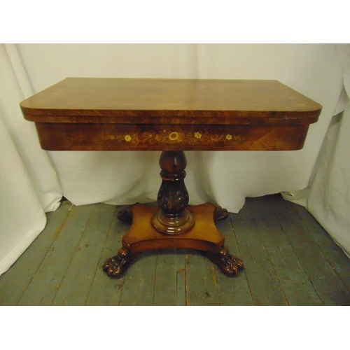 3 - A late Victorian rectangular walnut and mahogany games table on quatrefoil base with claw feet...