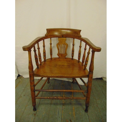 30 - A Victorian blonde oak occasional chair with turned spindles, scrolling arms on turned cylindrical l...