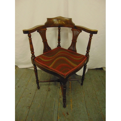 31 - An Edwardian inlaid oak corner chair with pierced slats and turned cylindrical supports...