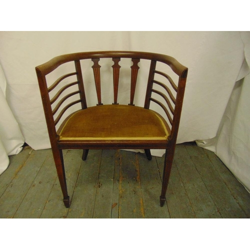 33 - An Edwardian mahogany slatted back chair on tapering rectangular legs...
