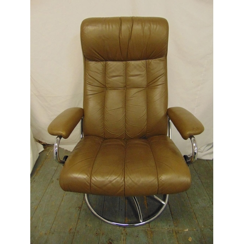 35 - A 1980s leather and chrome revolving armchair recliner...
