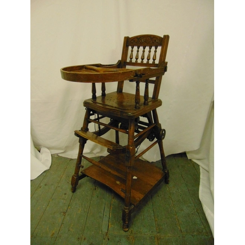 36 - An Edwardian oak metamorphic high chair on four turned cylindrical supports...