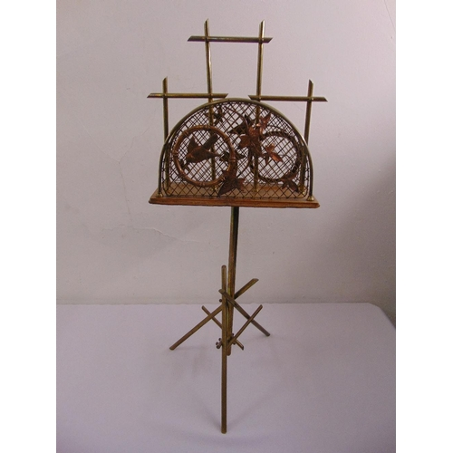 37 - An aesthetic style magazine rack with applied leaves and birds on triform base...