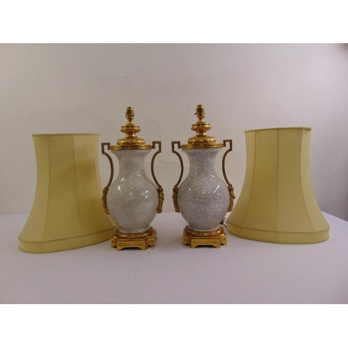 39 - A pair of porcelain cracked glazed vases with ormolu mounts converted to table lamps to include silk...