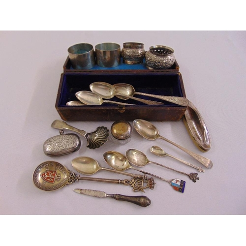 394 - A quantity of silver and white metal to include flatware and napkin rings...