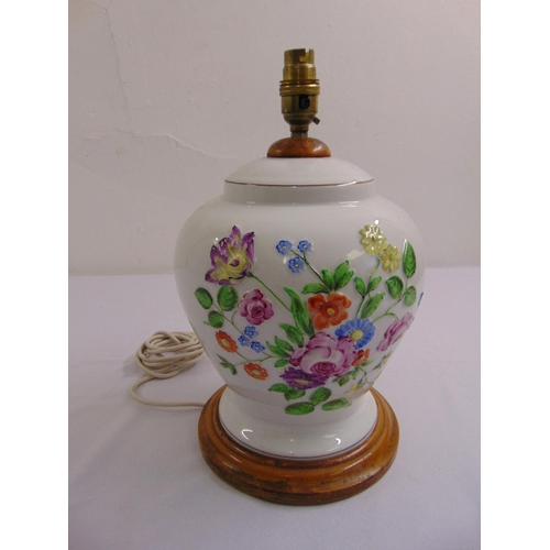 41 - A Herend baluster form porcelain lamp base decorated with flowers and leaves on turned wooden base...