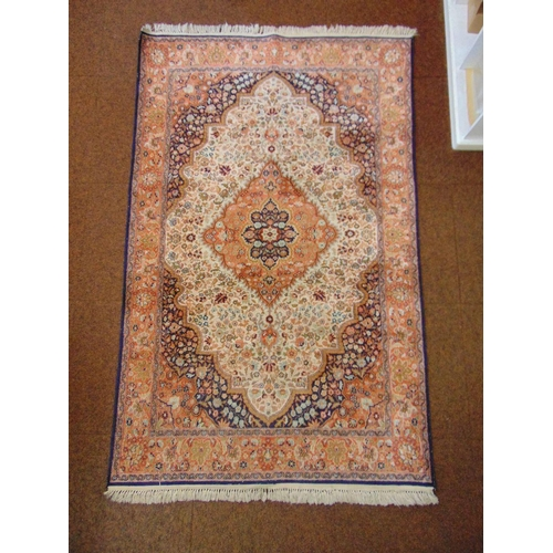 46 - A Persian wool carpet, red and blue ground central medallion within organic and stylised geometric f...