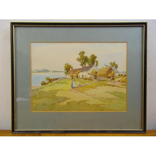 60 - A framed and glazed watercolour of an English country landscape, 26 x 36cm...