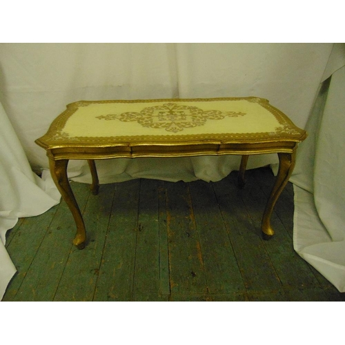 7 - A Florentine shaped rectangular coffee table on four cabriole legs...