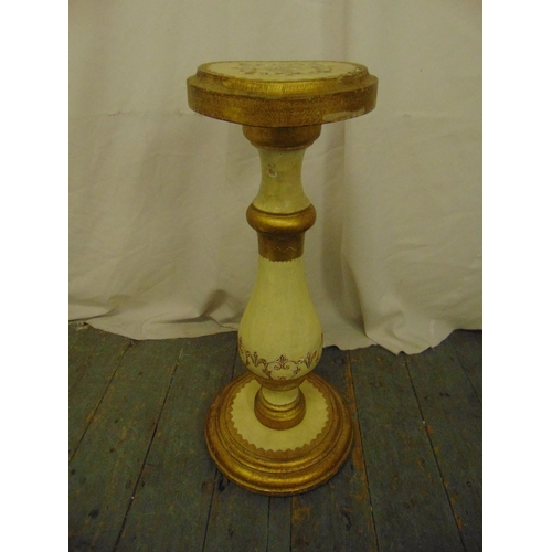 8 - A Florentine pedestal of baluster form with circular top on raised circular base...