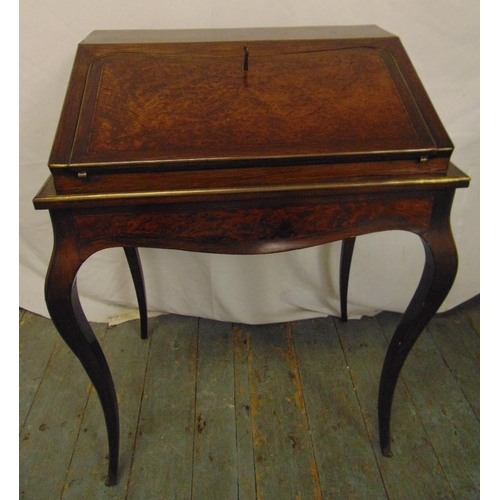 1 - A 19th century rectangular walnut and mahogany desk with brass mounts on four cabriole legs...