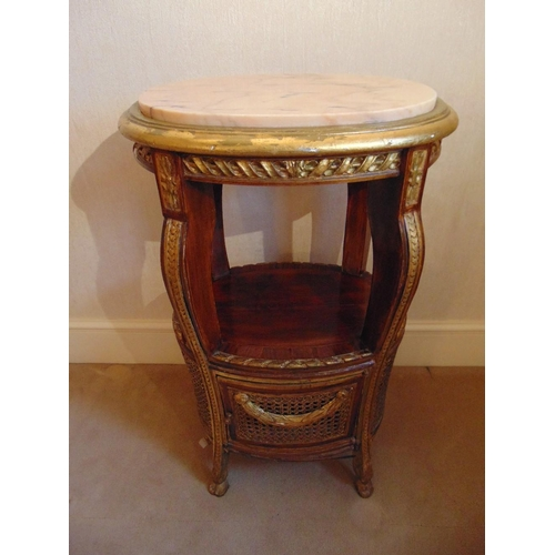 12 - An oval side table with marble inset top and bergere panels to the sides, A/F...