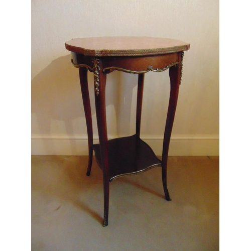14 - A mahogany side table of shaped rectangular form with marble top and cabriole legs...