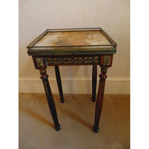 15 - A square gilded metal and marble side table with galleried top...