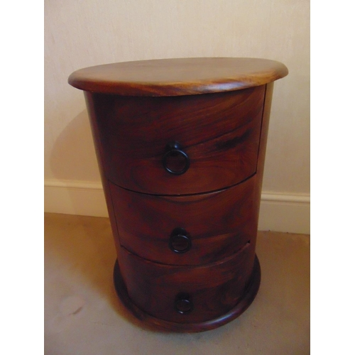 17 - A cylindrical mahogany three drawer side table...