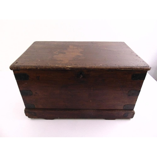 18 - An early 19th century rectangular mahogany chest with metal mounts and brass handles...