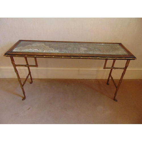 19 - A gilt metal and glass rectangular side table on simulated bamboo legs...