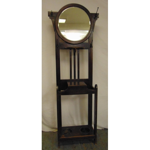 22 - A Victorian oak hall hat stand in arts and crafts form with oval mirror and integrated umbrella stan...