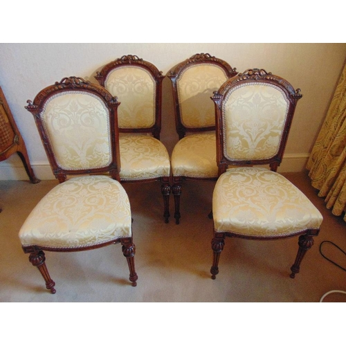 25 - Four Victorian upholstered dining chairs on tapering fluted baluster legs...