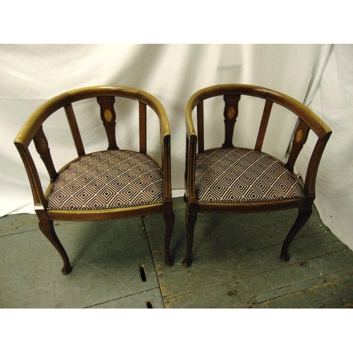 27 - A pair of Edwardian mahogany inlaid slatted back occasional chairs on cabriole legs...