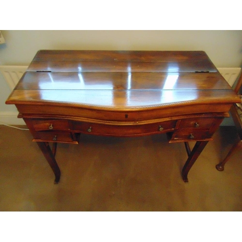 3 - A 19th century rectangular mahogany rise and fall bow fronted desk, the rise and fall mechanism reve...