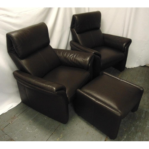 30 - A pair of leather armchairs and a matching foot stool...
