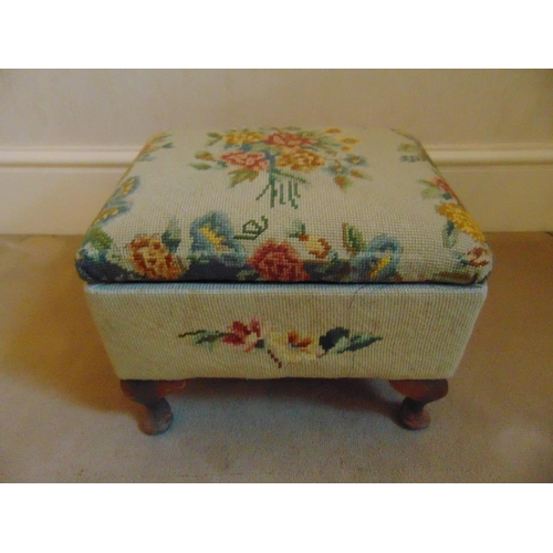 31 - A Victorian upholstered foot stool cum sewing box with accessories on four scroll feet...
