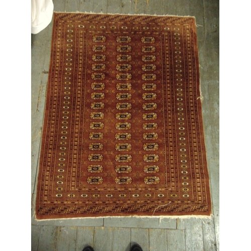 34 - Persian wool carpet red ground with geometric repeating pattern and border, 178 x 133cm...