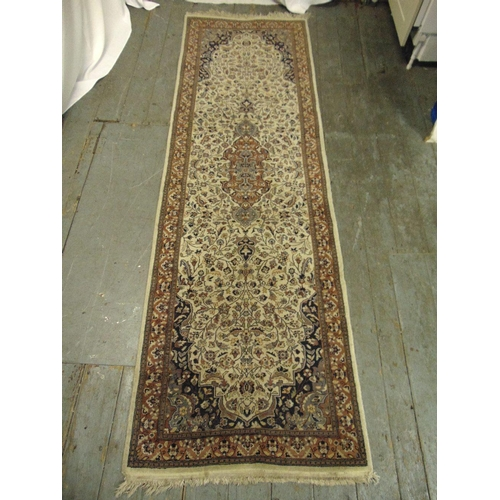 36 - A Persian wool runner brown ground and tan border with repeating floral pattern, 250 x 79cm...