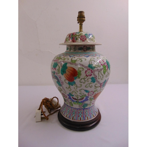 45 - A Chinese porcelain baluster vase decorated with flowers and butterflies, later converted to a table...
