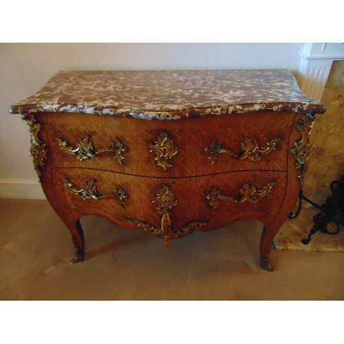 6 - A French Louis XVI style commode of shaped rectangular form with two drawers and marble top...