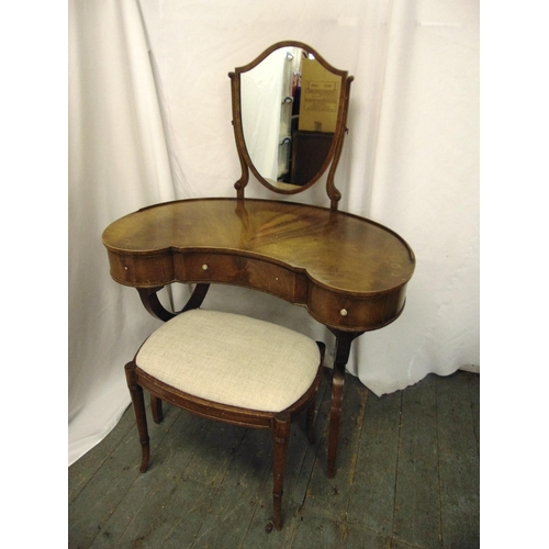 8 - An Edwardian kidney shaped mahogany dressing table and stool with shield shaped mirror...