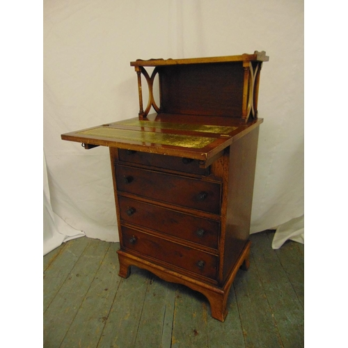 1 - An Edwardian rectangular desk with four drawers, hinged front and gallery shelf...