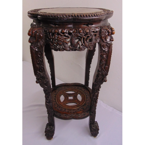 10 - A Chinese 19th century hardwood shaped circular side table with inset marble top the sides and legs ...