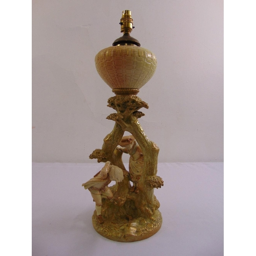 131 - A Royal Worcester porcelain oil lamp with figurines of a boy, girl and frog under a tree, signed to ...