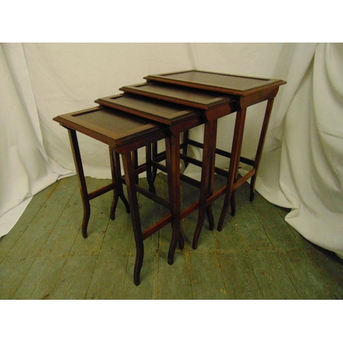 15 - Carl Hiess a nest of four rectangular mahogany tables...