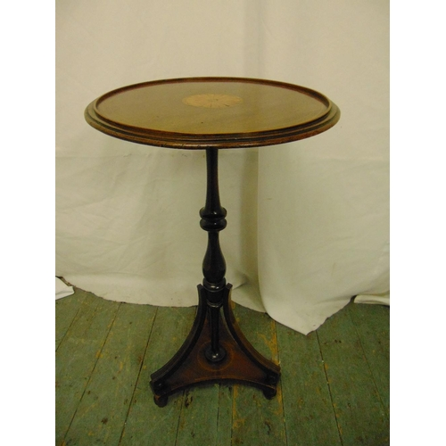 21 - An Edwardian circular mahogany inlaid side table, the knopped stem on triform support...