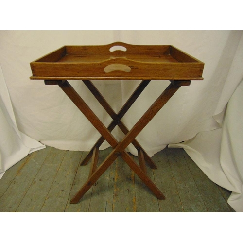 24 - A rectangular wooden butlers tray on articulated stand...
