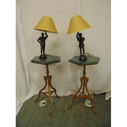 26 - A pair of hexagonal marble top side tables on triform bases with spelter figural table lamps and sha...