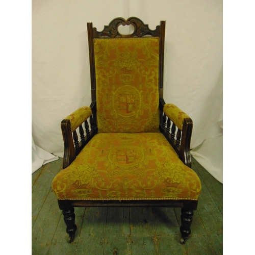 29 - An Edwardian mahogany upholstered armchair, galleried arms on four tuned cylindrical legs...
